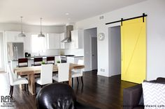 This creamy yellow barn door is a central conversation piece in this home.