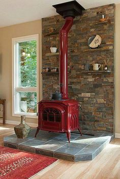Country Living Room with Hardwood floors, double-hung window, Breckwell cast iron wood stove red, Standard height, Fireplace Wood Stove Hearth, Stove Fireplace, Fireplace Ideas, Wood Stove Surround, Corner Wood Stove, Farmhouse Fireplace, Country Fireplace, Wood Stove Wall, Slate Hearth