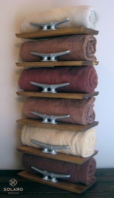 Distressed, nautical towel rack with 8 galvanized dock cleats to hold 6 rolled towels in place.  - Keyhole fasteners on the back to hang on a wall.: