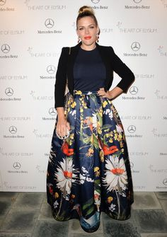 Busy Phillips  wore a+o's Tina Ball Gown floral print skirt paired with a navy tee and fitted blazer.