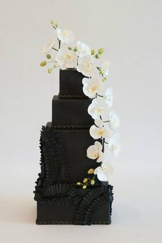 Featured Cake: Heartsweet Cakes; Unique square black textured wedding cake topped with white orchids