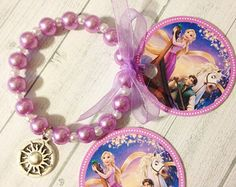8 - Princess Rapunzel Sun charm Pearl Bracelet Rapunzel Birthday or Slumber Party Favor Bracelet Rapunzel Party Favor Tangled Party by MichelleAndCompany on Etsy Toddler Jewelry, Kids Jewelry, Cute Jewelry, Slumber Party Favors, Princess Party Favors, Kids Bracelets, Handmade Bracelets, Beaded Bracelets, Necklaces
