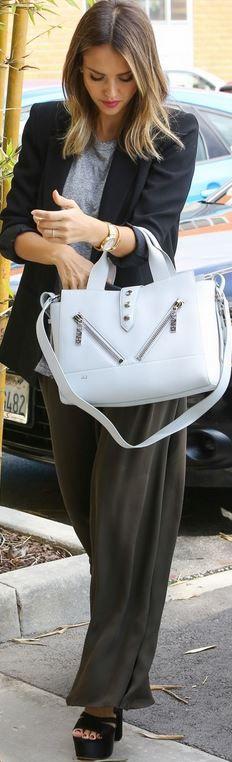 Who made  Jessica Alba's white handbag?