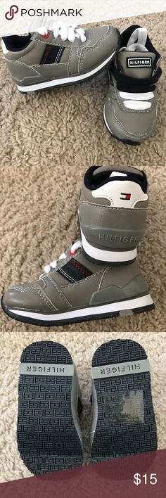 Tommy Hilfiger Shoes Brand new never worn kids shoes. Only has one of the blue shoelaces, it was taken out and misplaced. Tommy Hilfiger Shoes Sneakers