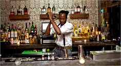 Karl Franz Williams, the owner of 67 Orange Street, making one of the bar's signature drinks