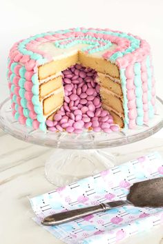 Gender Reveal Cake | An exciting gender reveal cake that is full of a surprise -- M&M's revealing the gender of the baby!