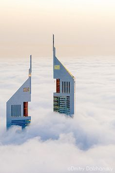 Emirates Towers, Dubai above the clouds // 500px by Dmitry Dolzhanskiy