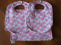 So cute and feminine, these bibs & burps feature tiny birds and flowers. A set of 2 bibs & 1 burp cloths - $30.00