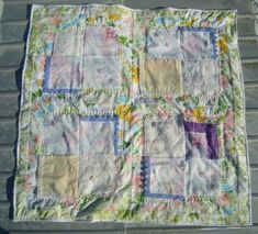Hankie Baby Quilt....so cute! and would be fun to go on a vintage hankie hunt at antique/resale shops etc.