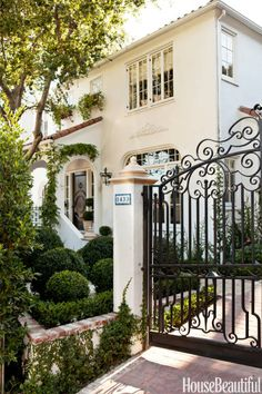 A wrought-iron gate designed specifically for the driveway of this 1920s house.