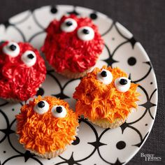 With bright orange and radiant red frosting, these cute, spiky monster cupcakes are more edible than menacing. Follow these simple steps to decorate the cupcakes: 1. Use a pastry bag with a grass tip to pipe on tinted orange or red frosting. 2. Pipe on white frosting for the monster eyes. 3. Make two dots with black frosting for the pupils./