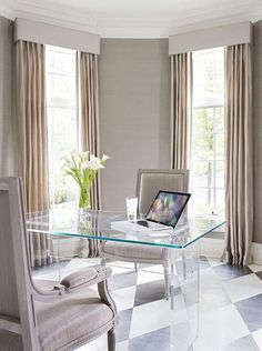 Home Office  A Lucite desk provides transparency and allows attention to be focused on the silver-leaf harlequin pattern on the floor.