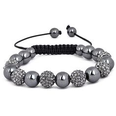 Stephani Crystal Bracelet The Stephanie Bracelets are the most talked about jewelry item so far this season. The grey crystal and hematite Stephanie bracelet consists of 17 piece grey Austrian Crystal Pavé Balls and hematite beads strung together with weaved black cotton and finished with a hematite beaded pull. $59.99 #jewelry #fashion #crystal #bracelet