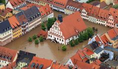 Flooding all over central Europe due to heavy rainfall. City hall of Grimma, Germany surrounded by flood water on June 3, 2013.