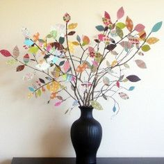 Branches in a vase with colored leaves on them