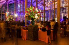 Tropical buffet arrangements on mossy pedestals.