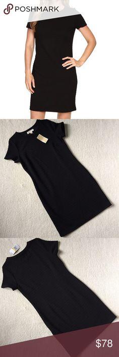 """Michael Kors Short Grid Texture Dress NWT Classic little black dress. Black, grid texture material. Size Medium. Length 36.5"""" Bust 34"""" Waist 32"""" Hip 37"""" 82% Polyester 16% Viscose MICHAEL Michael Kors Dresses"""