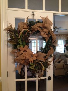 Rustic wreath: burlap ribbon, feathers, antlers