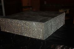 My DIY bling out cake stand! :  wedding cake stand bling.  Thinking of doing this with the same black rhinestones I have for the centerpieces.