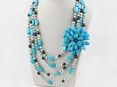 Big Style Multi Strand Pearl and Blue Turquoise Flower Necklace:http://www.aypearl.com/wholesale-turquoise-jewelry/wholesale-jewellery-X1405.html