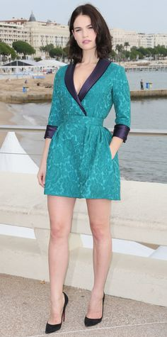 Lily James was radiant at the War and Peace photocall in a turquoise jacquard Ulyana Sergeenko tuxedo dress with contrasting navy satin lapels and lining.