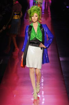 Jean Paul Gaultier Spring 2012 uses jackets with a pop of color and length to reminisce the 80s emphasis on jackets
