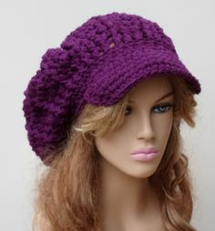 Larger tam in double-stranded worsted weight acrylic, soft, sturdy and carefree. Dark orchid which is a rich purple with red undertones, no blue undertones. I crochet these hats in a beret style with