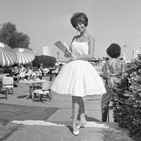 1962: This full skirt is enhanced by many starched petticoats, but in Palm Springs the sheer white cotton dress with spaghetti straps was a ...