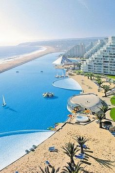 San Alfonso del Mar – Algarrobo, Chile! The pool at the San Alfonso del Mar is about 1 hour outside of Santiago, Chile, and is the biggest pool in the world! This pool is literally 1 kilometer long and holds 66 million gallons of water. This pool is so large that it supposedly costs $4 million a year to keep it up.  Click through to see 20 of the best pools on earth!
