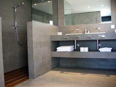 Paredes suelo y plato de ducha en microcemento