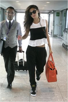 Nicole Scherzinger Adds A Pop of Color To Her Black & White Outfit At Heathrow