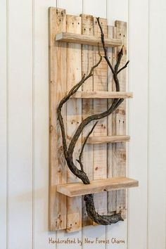 A beautiful, rustic piece of wall art that's handcrafted from reclaimed pallet shelves.