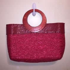 "Red Straw Bag with wooden handle. Perfect for the summer! Awesome red bag made of straw with vinyl. Wooden handle. Zip enclosed. One small pocket inside. Roomy interior. 15 1/2"" wide. 10""tall.wigszw Bags Totes"