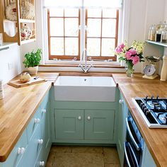 """Love this idea of a Kitchen that you """"wear' almost like the one pictured  -  To connect with us, and our community of people from Australia and around the world, learning how to live large in small places, visit us at www.Facebook.com/TinyHousesAustralia or at www.TinyHousesAustralia.com"""