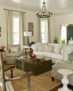 Loving this neutral living space.  Nailheads and the pillows especially.