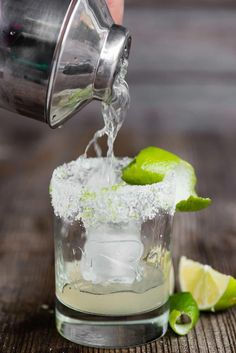 The most perfect classic Margarita recipe is quick and easy to make. This lip smacking tequila cocktail served over ice is the best drink! #margarita #recipe #ontherocks #classic #homemade #tequila #lime #tequillacocktails