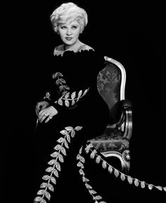 A dramatic, glamorous portrait of Mae West, 1930s.