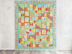 This critter-adorned quilt is created from a few simple blocks! Wild, right?