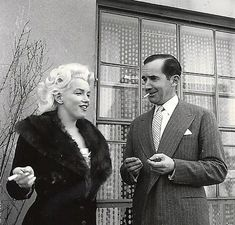 Marilyn Monroe with Edward R. Murrow during discussions at the Ambassador Hotel in New York regarding her forthcoming appearance on Murrow's Person To Person television show in 1955. Photo by Milton Greene.