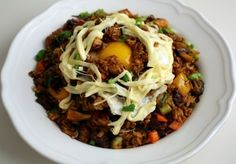 Fried rice (Bokkeumbap) Made with: beef, carrot, cheese, chicken, eggs, garlic, green chili pepper, green onion, ground black pepper, ham, kimchi, onion, oyster sauce, pork, red bell pepper, rice, sesame oil, vegetable oil, white oyster mushrooms, yellow bell pepper, zucchini