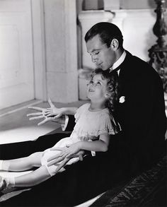 Gary Cooper and Shirley Temple. If I remember the autobiography correctly, this was shortly before she wet her pants. She was so embarrassed she sobbed and sobbed. Her mama cleaned her up, told her it was time to be brave, and sent her back out.