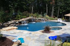 Water Feature Swimming Pool in Bergen County, NJ: Water feature swimming pool in Franklin Lakes, Bergen County , NJ.   The man made waterfalls are constructed of Pa. colonial boulders.