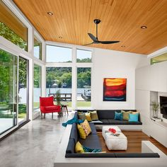 Modern Midcentury Sunken Living Room Interior Built In Grey Sectional Couch And Red Upholstered Armchair Also Concrete Wooden Flooring Design Ideas: Contemporary Ski Shores Lakehouse by Stuart Sampley Architect