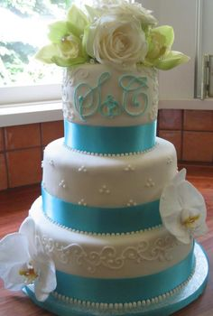 This so far is my favorite wedding cake!  I love the monogram :)