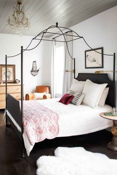 Airy Room:  In singer-songwriter Holly Williams's Nashville bedroom, cloudy grey covers the pine-clad ceilings to create the perfect backdrop for rustic decor and a collection of antiques.