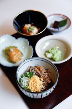 Monk food: (Clockwise from left) Nasu dengaku (fried eggplant with sweet miso), tofu, red-bean paste dessert, shirotama zunda ae (rice dumplings with soybean paste) and cold buckwheat noodles with toppings.   LUUVU HOANG