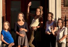 Girls wearing Kate Middleton masks pose outside the hospital as the UK prepares for the birth of the first child of The Duke and Duchess of Cambridge at on July 18, 2013 in London, England