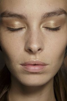 TRY..Gold eyeshadow.  Clean Make-up and closer attention to brow grooming
