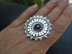 Ring | Sasha Bell.  Sterling silver and garnet.