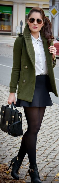 very blair waldorf. Military pea coat, black skirt, white button up, tights and chic ankle booties.